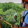 John Cross<br /> A Kerfoot Canopy Tour staff member watches as a rider sets up for a zip-line ride over the trees.