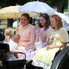 Pat Christman<br /> From left, Kara Schmedding, Leah Klammer and Isabella Stading, portraing Katie, Betsy and Tacy from the popular Maude Hart Lovelace books,take a ride on a horse drawn carriage during the Betsy-Tacy Lawn Party & Lincoln Park Historic Home & Garden tour Saturday.