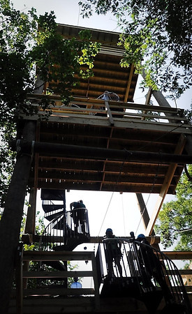 John Cross<br /> Visitors to the Kerfoot Canopy Tour wind their way up a 60-foot-tall tower from which several zip-lines originate.