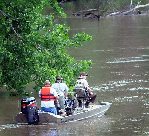 John Cross<br /> A boat from the Nicollet County Sheriff's Department searches the Minnesota River near Courtland for Stephen Fritze of Watertown, S.D. Fritze is presumed drowned while kayaking Saturday with friends.