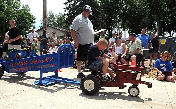 Pat Christman<br /> Spectators watch 6-year-old Zander Krohn during his pedal tractor pull Saturday at Nicollet Friendship Days.
