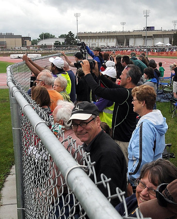 Pat Christman<br /> Spectators watch in wonder as the twin Gage Towers fall during Saturday's implosion.