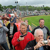 John Cross<br /> Spectators climbed atop the roof of a dugout at MSU's baseball field to view the implosion Saturday of Gage Towers.