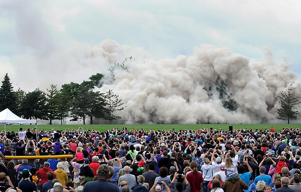 John Cross <br /> The fallen Gage Towers is enveloped in a cloud of dust after scores of explosive charges brought the Mankato skyline landmark down in a controlled implosion on Saturday.