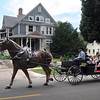 Pat Christman<br /> Visitors take a ride through the Lincoln Park neighborhood during the Betsy-Tacy Lawn Party & Lincoln Park Historic Home & Garden tour Saturday.