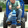 Pat Christman<br /> Noah Walton, 5, struggles to get a few more inches during his pull Saturday.