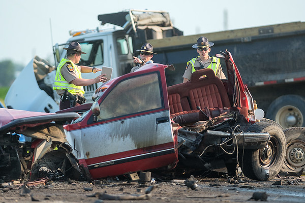 Three State Troopers look over the scene of a five-vehicle accident on Highway 60 just south of Madison Lake on Friday evening. Photo by Jackson Forderer