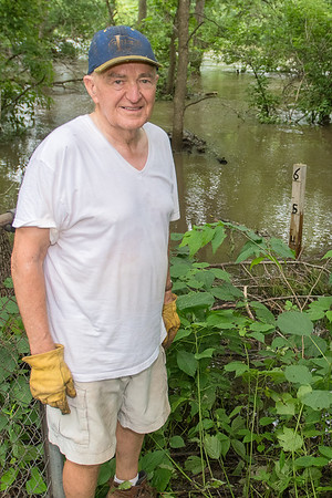 """Bob Herickhoff has put a post (at right) in his yard measuring floodwaters from the Blue Earth and Watonwan Rivers. """"You haven't helped us people upstream a damn bit,"""" Herickhoff said of the federal government who is running the Rapidan Dam. Photo by Jackson Forderer"""