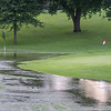 The eighth green at Riverside Country Club in rural Winnebago has a temporary new water hazard due to a downpour of rain on Sunday. The course is still playable as the waters recede. Photo by Jackson Forderer