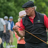 Mark Suedbeck checks out the hickory club he was given to golf with as he and other Mankato Golf Club members tried out the vintage clubs on the driving range. Photo by Jackson Forderer