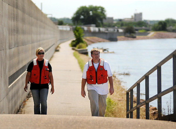 Mikayela Munson (left) and Jim Tatge, engineer technicians with the City of Mankato, have been patrolling the levee/dike system twice a day in the aftermath of heavy rains. Plans are in place to begin 24-hour patrols if the Minnesota River stage exceeds 25 feet. It is expected to crest at around 25.2 feet on Sunday afternoon, barring any more heavy rain events. Photo by John Cross