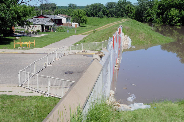 Removable steel panels on Highway 93 leading into Henderson from the south keep the Minnesota River at bay. Similar gates are in place where Highway 19 comes into Henderson from the east. Highway 93 on the north end of Henderson also is flooded. Photo by John Cross