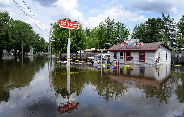 O'Leary's Bait and Tackle shop in Waterville as well as neighboring homes and RVs are surrounded by flood water. Photo by John Cross.