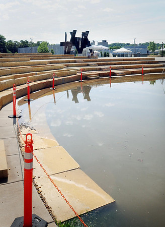 A front row seat at the Vetter Stone Amphitheaterat Riverfront Park would be a soggy one right now. The grassy expanse in front of the stage has been transformed into a reflection pool as a result of high water from the nearby Minnesota River. Photo by John Cross