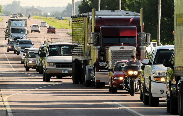 A stream of traffic comes into North Mankato on County Road 13 Monday morning after being detoured from Highway 169 at St. Peter. Photo by John Cross