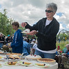 Rachel Wood serves up a piece of strawberry pie at the Dodd Ford Bridge celebration on Saturday in Amboy. The bridge was scheduled to be taken down completely in 2007 but it has been rebuilt and saved by local residents. Photo by Jackson Forderer