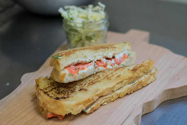 A grilled cheese sandwich made with smoked salmon, dill cream cheese on Tandem Bagel's artisan bread with a side of simple slaw will be the seventh of a 10 course meal that will be made by a group called the Chef and Farmer Collective. The group will be cooking for a pop up restaurant called the Gathering Table outside of Tandem Bagels on July 7. Tickets are limited to 50 and need to be purchased before hand. Photo by Jackson Forderer