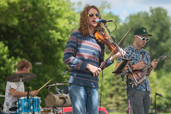 The band Feed the Dog from Wisconsin plays on the main stage at the Solstice Outdoor Music Festival held at Land of Memories Park on Saturday. Photo by Jackson Forderer