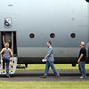 "Members of the media, including Free Press reporter Dan Linehan (center) board the Blue Angels' C130 support aircraft, called ""Ernie,"" before a flight Friday."