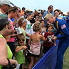 Blue Angels pilot Lt. C.J. Simonson, of Coon Rapids, signs autographs with the rest of the pilots at the end of Sunday's air show at the Minnesota Air Spectacular at the Mankato Regional Airport.