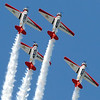 The Aeroshell Aerobatic Team performs for the crowd Saturday.