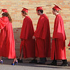 Mankato West seniors walk into the building before the school's commencement ceremony Thursday.