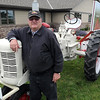 "Dean Lee restored an INternational Harvester Farmall ""C"" tractor, with its rare promotional white paint job that will be used to promote the Crystal Valley Cooperative in area parades."