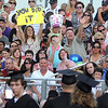 A Mankato East graduate's family holds up signs of support during the school's commencement ceremony Thursday.