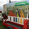 Lee's tractor includes a float promoting the Crystal Valley Cooperative.