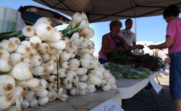 Sweet onions are stacked and ready for sale at Pietsch's vegetable stand Tuesday at the Mankato Farmers Market.