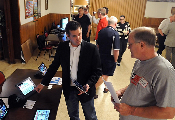 Pat Christman<br /> Shawn Donahue of Express Games explains the company's e-gaming system to Albert Lea Moose Lodge gaming manager Bob Sorenson during an e-gaming seminar Wednesday at the Mankato Eagles club.