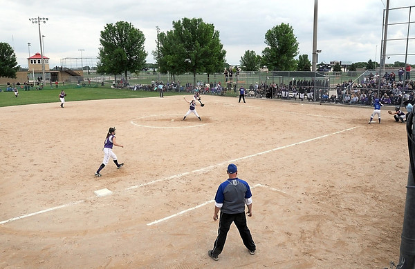 Pat Christman<br /> The New Ulm softball team plays Kasson-Mantorville in Friday's State Class A softball tournament championship game at Caswell Park.