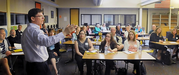 John Cross<br /> St. Peter High School teacher David Kennedy makes a presentation to area teachers during a Professional Leaning Community conference Wednesday at Mankato East High School.