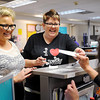 John Cross<br /> Anna Kelley (left) and Jenn Melby apply for a marriage license Friday at the Blue Earth County License Center. They were the first  couple to apply in Blue Earth County for a license after the 2013 Legislature legalized same-sex marriages.