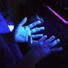 Pat Christman<br /> A student looks at germs on her hands under a black light during a session about hand washing Thursday.