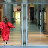 Pat Christman<br /> A Mankato West senior rushes toward MSU's Myers Field House to line up for commencement Thursday.