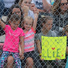 Hannah Kleschult (second from left) encourages Jorie Perron (left), 6, and Jayda Hager, 6, in cheering for the St. Peter Saints softball team as they played for the championship against Maple Lake on Friday. Unfortunately for Saints fans, the team fell short and lost 11-1 in the game played at Caswell Park. Photo by Jackson Forderer