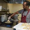 Ahmed Musse puts sambusa into a frying pan in the kitchen at Brothers Restaurant and Grocery. Sambusa is an African pastry filled with meat. Photo by Jackson Forderer