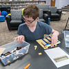 Blake Ready, an autistic 9th grader at Janesville-Waldorf-Pemberton, builds a Lego replica of the Janesville bowling alley during a community education class on Tuesday. Photo by Jackson Forderer