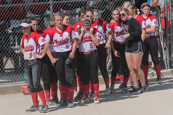 The Mankato West softball team emerges from the dugout after suffering their toughest loss of the season to Northfield 8-3 in the Class AAA championship game played on Friday at Caswell Park. Photo by Jackson Forderer