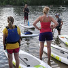 Bent River Outfitter's Dain Fischer teaches a group of stand up paddleboarders the basics Friday. Photo by Pat Christman