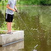 Ethan Case of Mankato is a picture of concentration as he fishes at Madison Lake's Buckmaster Bridge on Friday. It is Take-A-Kid-Fishing weekend through today. Photo by John Cross