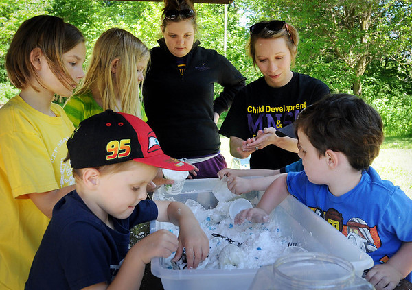 Minnesota State University, Mankato student Bridget Burkholz (back left) and Heather VonBank, a professor in MSU's Family Consumer Science Department, supervise youngsters participating in a Parent-Child Play Day on Friday at Rasmussen Woods.