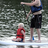 Jake Huebsch and his stepson Ezra, 5, take a cruise on a stand up paddleboard Friday. Photo by Pat Christman