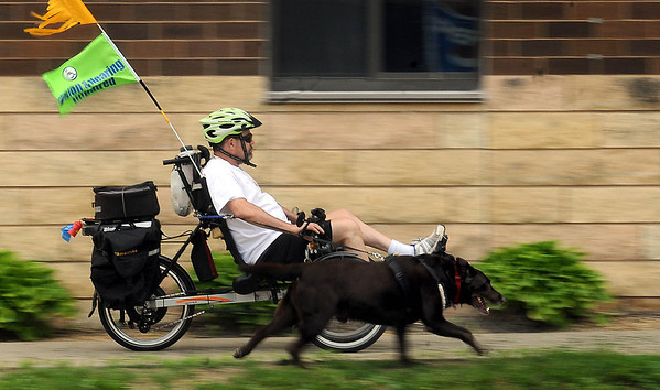 Rick Blace of Mankato and his service dog, Marti, cruise down South 2nd Street while running errands with his recumbent TerraTrike on Tuesday. Photo by John Cross