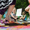 Youngsters used some fancy footwork and bubble wrap to create some art at a Parent-Child Play Day at Rasmussen Woods on Friday. The annual event was held by Minnesota State University, Mankato's Department of Family Consumer Science. Photo by John Cross