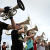 Members of the Mankato 77 marching band participate in drills during spat camp at Dakota Meadows Middle School on Monday to prepare for the upcoming performance season. There will be a Meet the Lancers event with the band performing at 7 p.m., Wednesday at the school. That is preceded by a hog roast fundraiser at 5:30 p.m. Photo by John Cross