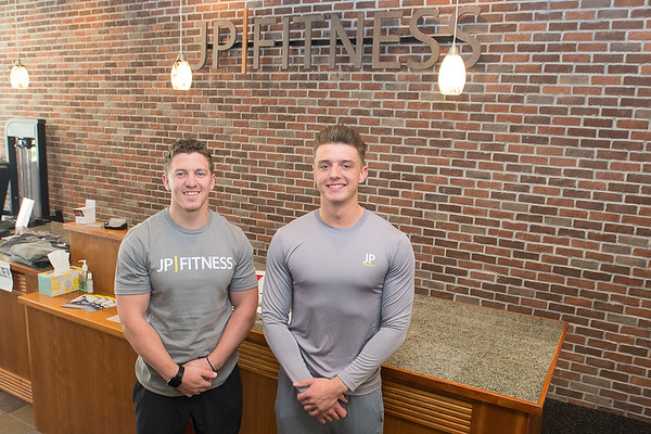 Jon Jamieson (left) and Mason Holecek (right) at JP Fitness in downtown Mankato. Jamieson is the owner of the gym and Holecek works as a personal trainer. Photo by Jackson Forderer