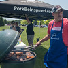 Charlie Torgerson grills ham at the pork tent during the Kiwanis Cookout held in Land of Memories Park on Saturday. Torgerson was not cooking for a competition but gave out tips to people on how to grill different kinds of ham. Photo by Jackson Forderer