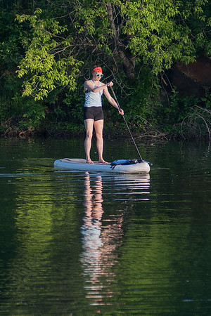 Yoga instructor Betty Harsma paddles back to shore after teaching a yoga class on a pond at Red Jacket Park. Photo by Jackson Forderer